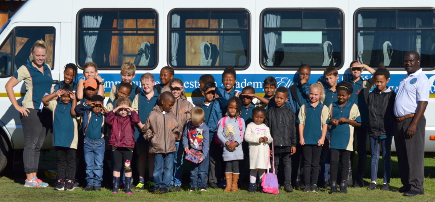 Learners pose in front of our school bus