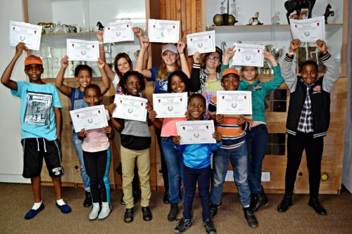 Happy campers receive achievement certificates